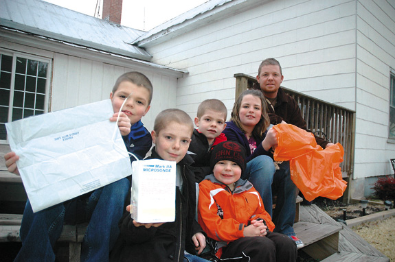 Four-wheeling family finds weather balloon