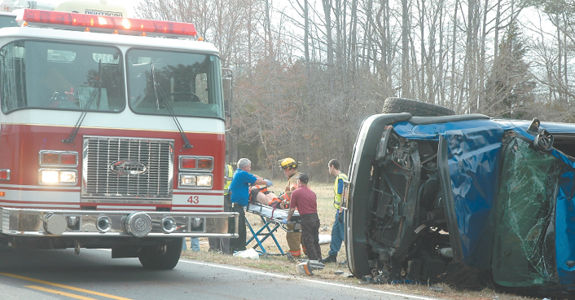 Truck overturns, driver ejected