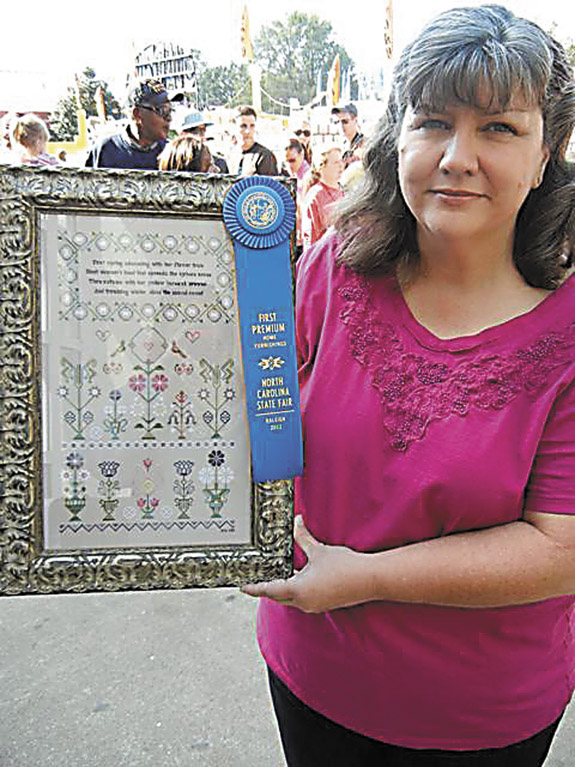 Cross-stitching wins Youngsville nurse honors at the State Fair