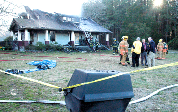 House fire leaves woman dead, man injured