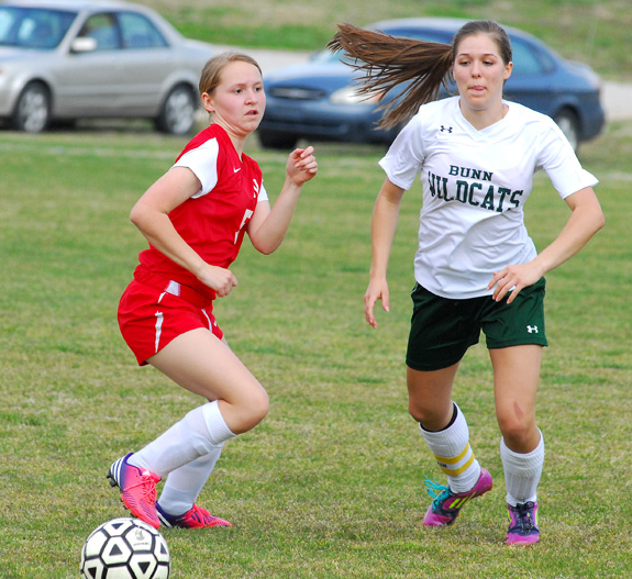 LEVINSON LUNGES TOWARD THE BALL