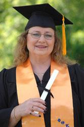 <i>Local woman earns degree</i>