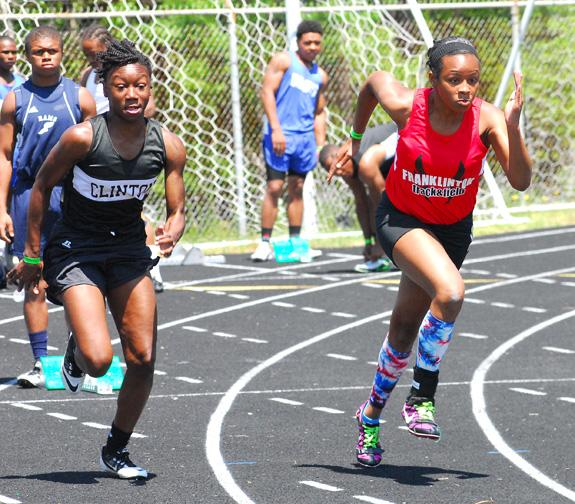 Shaniece soars on the track
