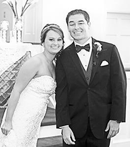 <i>Church ceremony unites couple</i>