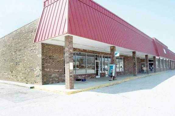 Local group buys Louisburg shopping center; announces, 'We don't want it to be vacant'