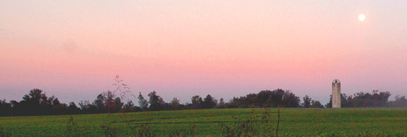 Sunrise with a moonset off Mort Harris Road