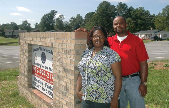 Couple uses faith and education to improve Academy Village