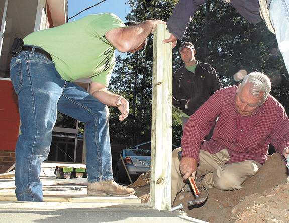Day of Caring continues after weather delay