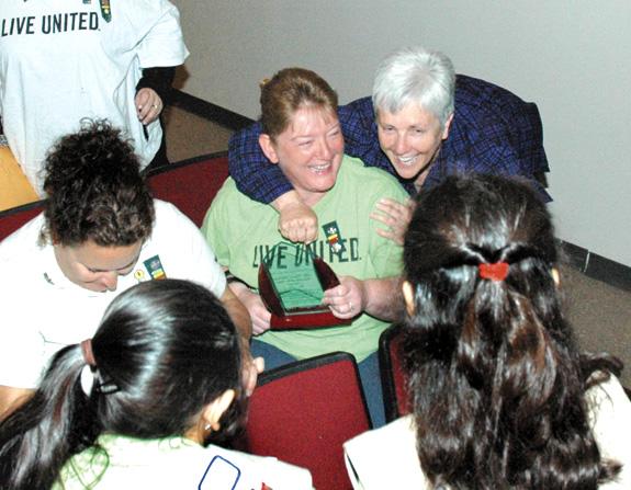 Volunteer Betty Craig saluted