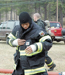 <i>Trial by fire! Area firemen hone their skills</i>