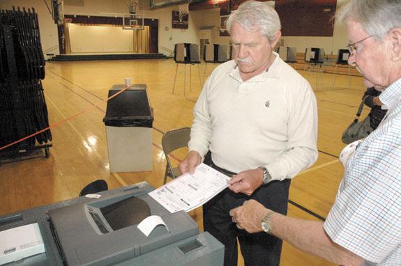 Chastain keeps clerk's post; Waters is DA