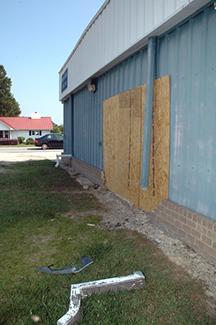 Car slams Bunn Rescue building, texting blamed