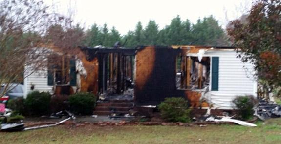 Blaze destroys home, contents; but local family escapes injury