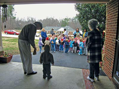 Young neighbors bring gift of Christmas song and joy