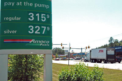 Gas prices hit high, dip just a bit locally