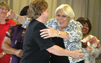 School system hands out hugs, congratulations